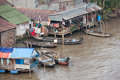 Daily life scene of the floating village at Mekong Delta Royalty Free Stock Photo