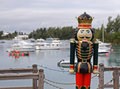 Life size christmas toy soldier a decoration overlooking a natural harbour Stock Image