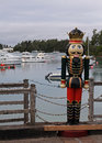 Life size christmas toy soldier a decoration overlooking a natural harbour Royalty Free Stock Photos