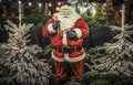 Life size santa full ornament with christmas trees for sale at a christmas market Royalty Free Stock Photos