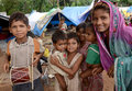 Life on the street woman and group of children living in poverty in hariyana india Royalty Free Stock Photo