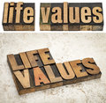 Life values in wood type words vintage letterpress text and one against a ceramic tile background Stock Photos