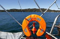 Life vest in a sailing boat and flashlight Stock Photography
