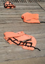 Life vest on wood floor Royalty Free Stock Photography