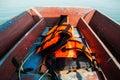 Life vest on wooden boat l odfkjsdsj f ife Royalty Free Stock Photography