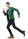 Life and work balance asian young man running with casual clothes mix business suit concept of Royalty Free Stock Photography