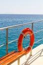 Lifebelt photo of orange on the ship Stock Photo