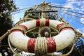 Lifebelt on the wooden mast Royalty Free Stock Photo