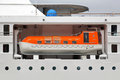 Lifeboat enclosed on a big cruise ship Stock Photos