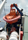 Lifeboat hanging on a ferryboat Royalty Free Stock Photos