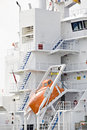 Lifeboat modern on cargo ship Stock Photo