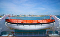 Lifeboat on the queen mary white and orange hangs from side of above long beach california Stock Images