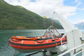 Lifeboat on a ship being winched from the side of Stock Photo