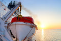 Lifeboat view of a on a cruise ship at sunrise Stock Image