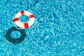 Lifebuoy on blue water surface with place for text Royalty Free Stock Photo