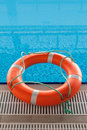 Lifebuoy in blue water in swimming pool Royalty Free Stock Photo