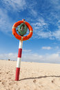 Lifebuoy on a column in the desert Royalty Free Stock Photos