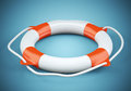 Lifebuoy on dark blue background Royalty Free Stock Photo