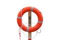 Lifebuoy on the harbor, white background. Royalty Free Stock Photo