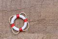Lifebuoy a lying on wood Royalty Free Stock Photo