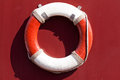 Lifebuoy on the maroon wall Stock Image