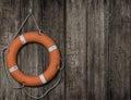 Lifebuoy on old wood background Royalty Free Stock Photo