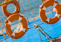 Lifebuoy ring ship railing and view from the deck of a boat sea travel background with lifebuoys Stock Image
