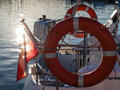 Lifebuoy on sailboat and polish ensign closeup rescue red life preserver saver ring flag Stock Photography