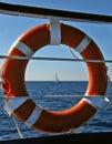 Lifebuoy and sailing boat Royalty Free Stock Photo