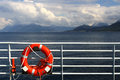 Lifebuoy on ship railing at fiords area Stock Images