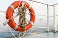 Lifebuoy in supply boat on the sea Stock Images