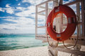 Lifebuoy on the tropical beach Royalty Free Stock Photography