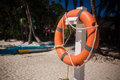 Lifebuoy on the tropical beach Royalty Free Stock Images