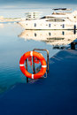 Lifebuoy with yacht on the background photo taken in port of valencia spain Royalty Free Stock Photography