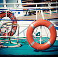 Lifebuoys ship railing and life buoy view from the deck of a boat sea travel background with Royalty Free Stock Photos