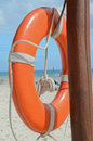 Lifeguard beach rescue equipment orange lifebuoy Royalty Free Stock Photo