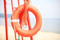 Lifeguard beach rescue equipment orange lifebuoy Royalty Free Stock Photo