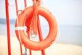 Lifeguard beach rescue equipment orange lifebuoy life saving buoyancy aid Royalty Free Stock Images