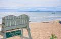Lifeguard chair at the beach white wooden on duty Stock Images