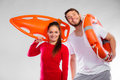 Lifeguard couple with rescue equipment Royalty Free Stock Photo