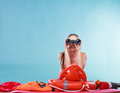 Lifeguard on duty with rescue buoy supervising. Royalty Free Stock Photo