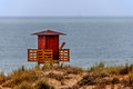 Lifeguard house under the rain lifeguards in winter a sailingboat in horizon Royalty Free Stock Photography