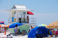Lifeguard stand on busy clearwater beach florida closeup of a booth a very sunny afternoon with lots of umbrellas and people Royalty Free Stock Photography