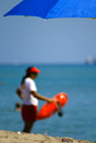 Lifeguard standing on the beach with a float miami miami dade county florida usa Stock Photography