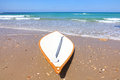 Lifeguard surf board on the beach Stock Photos