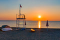 Lifeguard tower beach sunset sunrise parasol boat Royalty Free Stock Photo