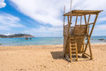 Lifeguard tower sandy beach white clouds sea blue sky figueral ibiza Royalty Free Stock Photography