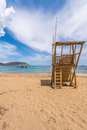 Lifeguard tower sandy beach white clouds sea blue sky figueral ibiza Royalty Free Stock Image