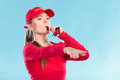 Lifeguard woman in cap on duty blowing whistle. Royalty Free Stock Photo