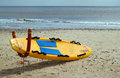 Lifeguards body board on a beach lifeguard propped up and ready for action uk rnli now patrol beaches around the uk and the Royalty Free Stock Image